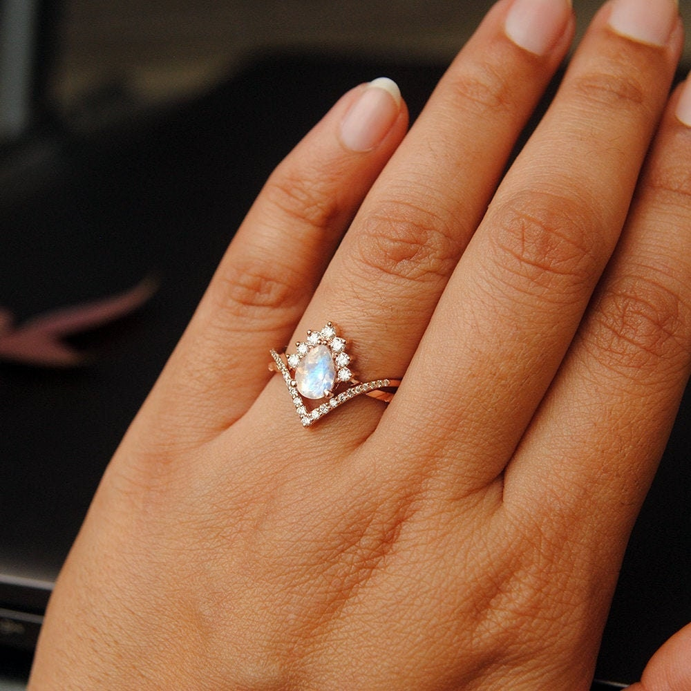 Interlocking moonstone and diamond ring set from Abhika Jewels