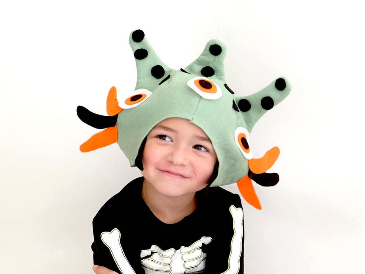 A child wearing a hand-sewn monster mask created from an Imaginary Tail sewing pattern.