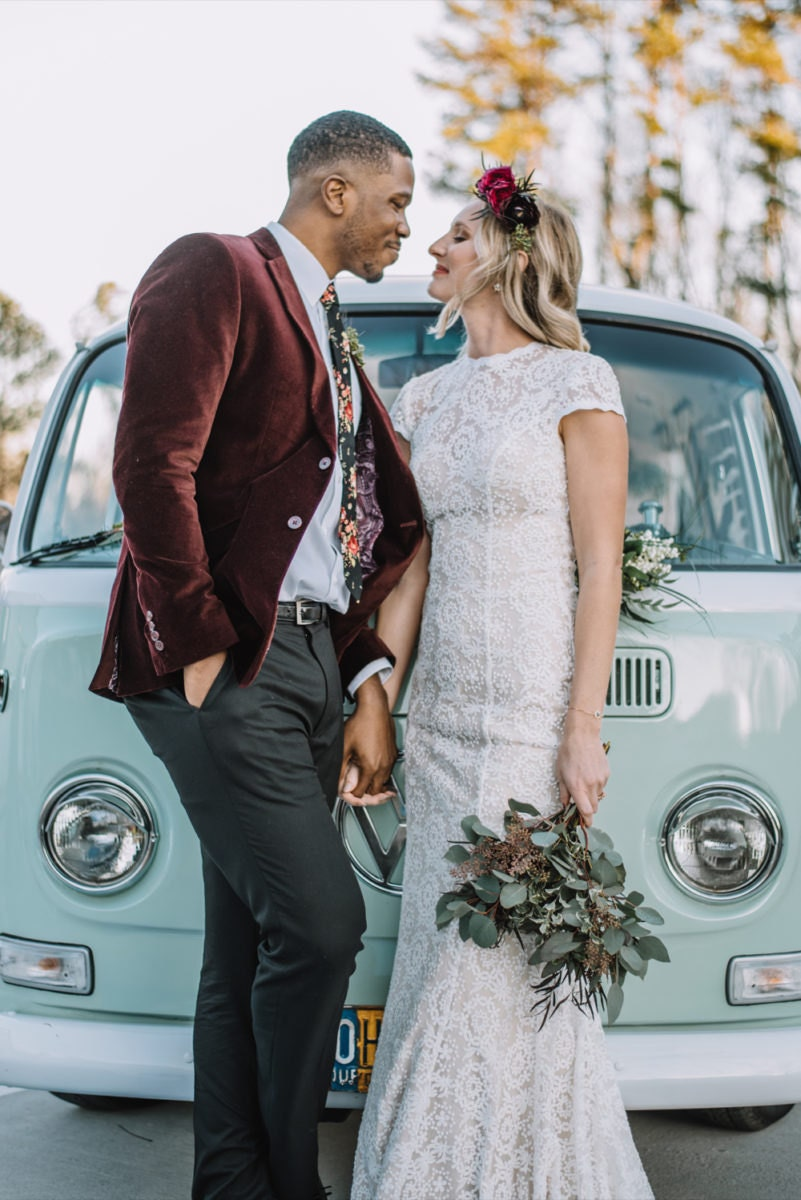Emily and Terrell pose in front of their mint green van-turned photobooth
