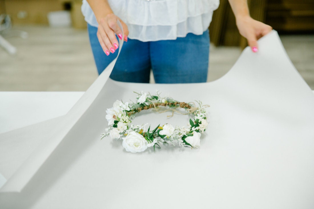 Brittany packages a white flower crown for shipping
