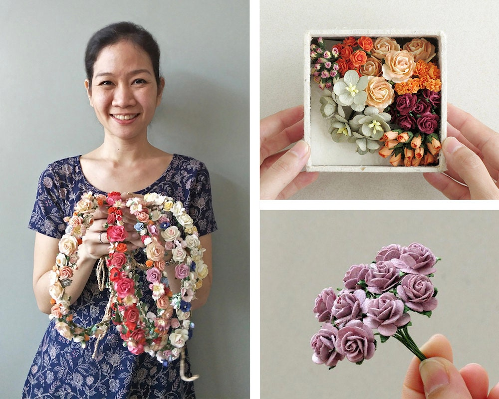 A portrait of craft supply seller Orawee Choedamphai collaged with some miniature paper flowers from her collection