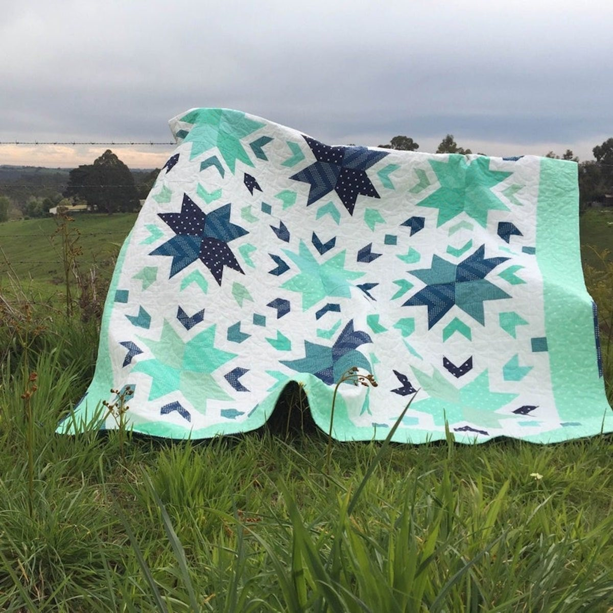 A starflower quilt pattern from Etsy