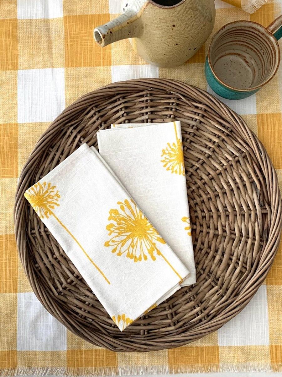 Dandelion dinner napkins from Mesa D'Amore, on sale for summer at Etsy