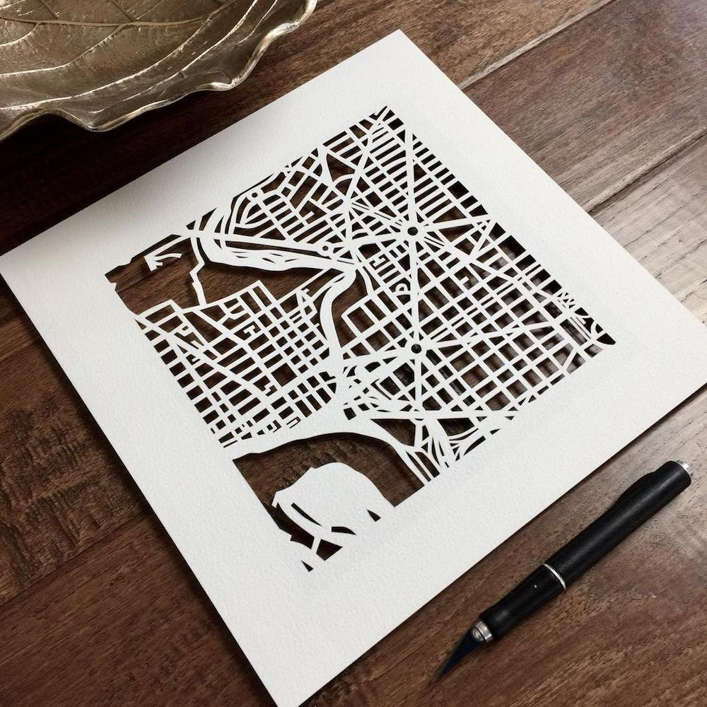 Curated image with Custom hand-cut paper map from Studio KMO, $175