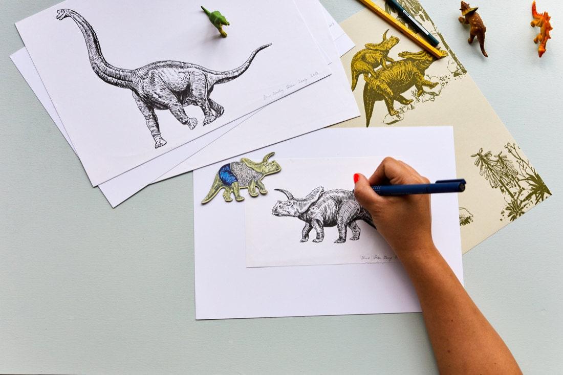Sian illustrates a triceratops for her award-winning dinosaur wallpaper design.