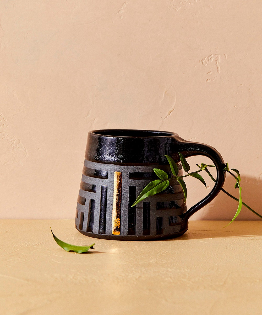A black and gold mug.