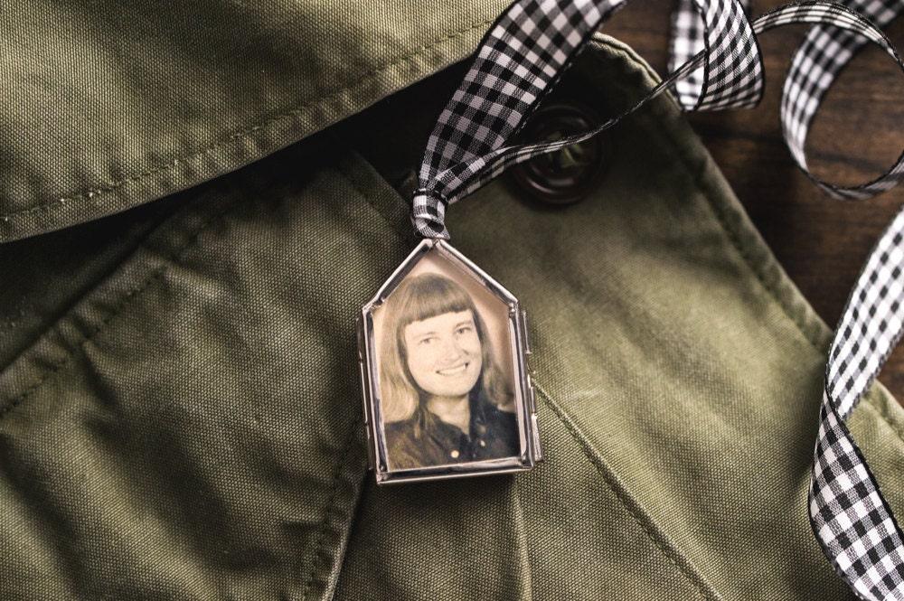 DIY photo locket strung on a checkered ribbon