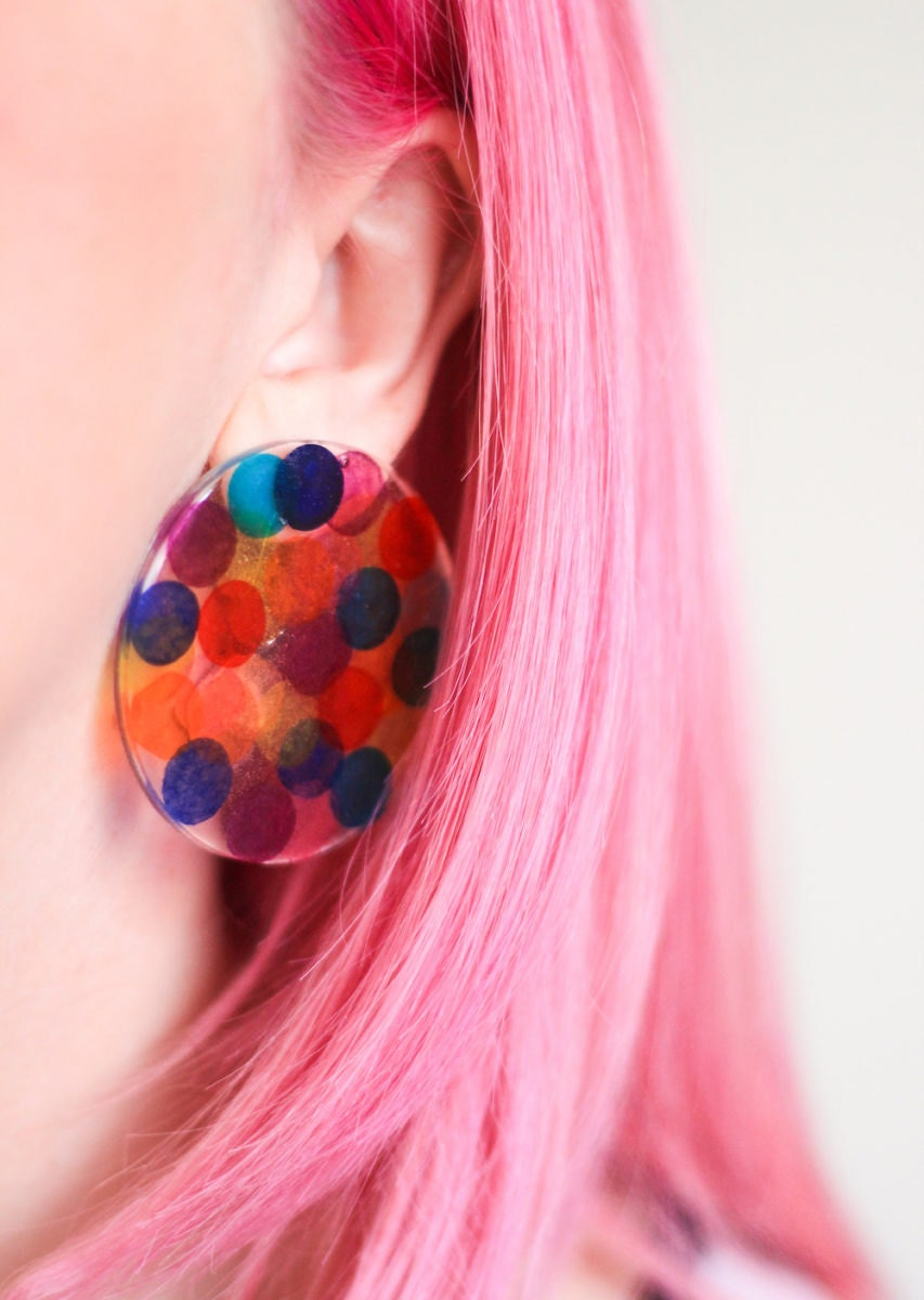 Rachel models handmade resin confetti earrings
