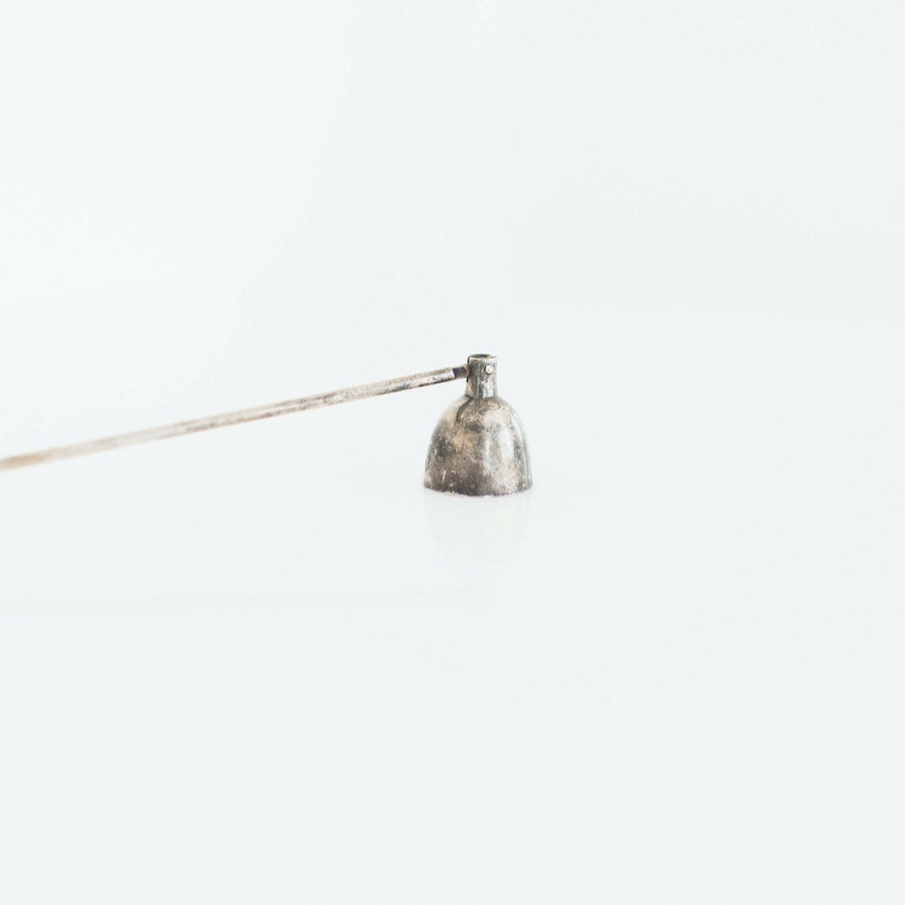 A vintage candle snuffer from Otherwise Shoppe.