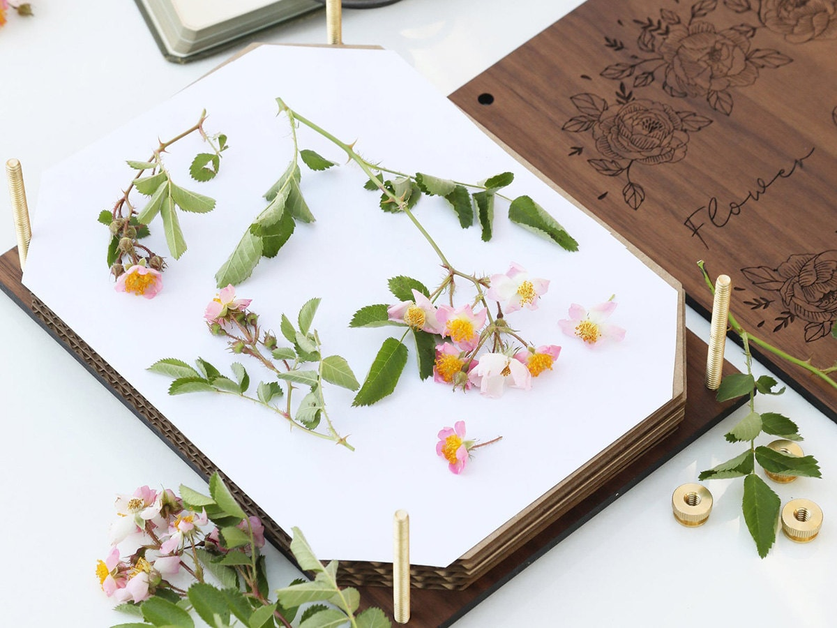 A flower press with flowers inside.