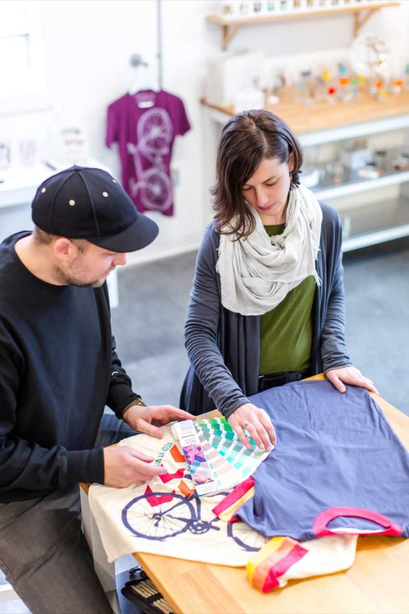 Brett and Crystal discuss color options for a screenprinted T-shirt design.