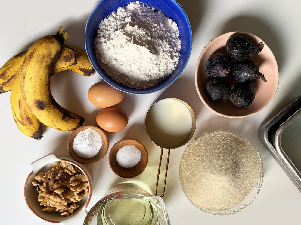 Banana bread ingredients laid out on a table.