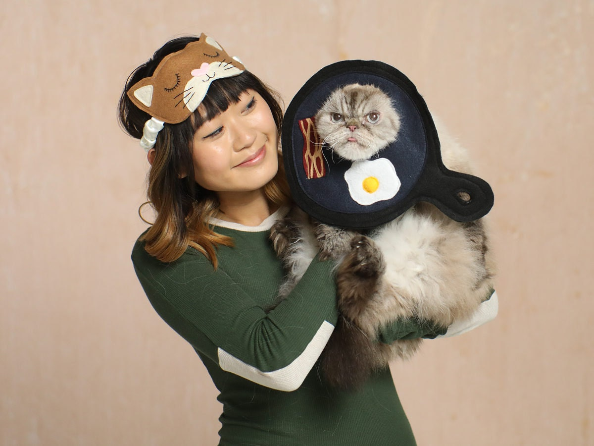 A woman and her cat dressed like