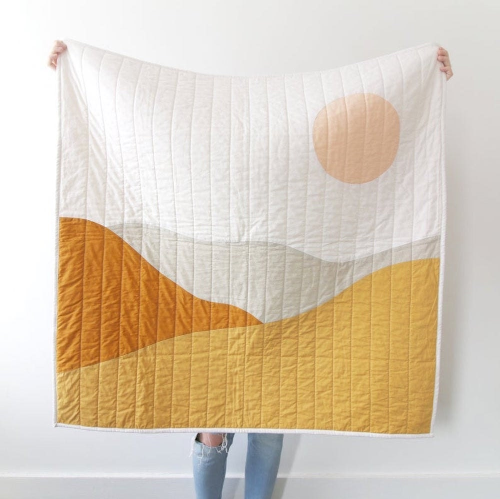 A desert landscape quilt from Kindred Quilting Co.