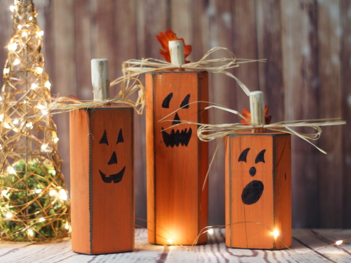 Trio of wooden jack-o'-lanterns from GFT Woodcraft