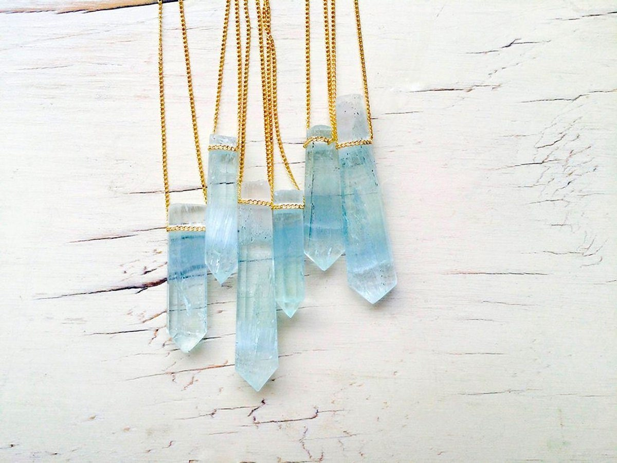 Cluster of six aquamarine pendant necklaces from Robin Woodard