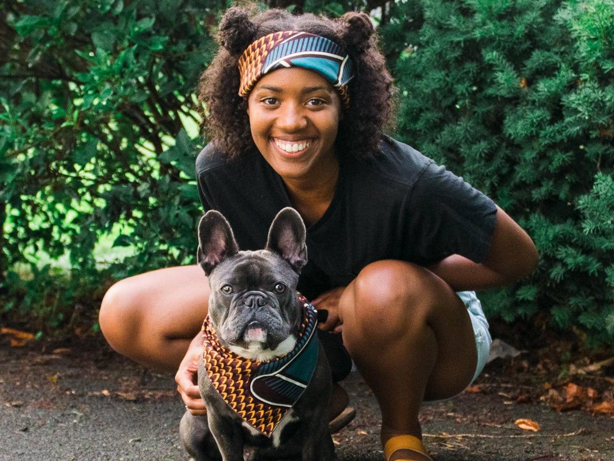 A girl and her dog modeling matching headband and bandana.