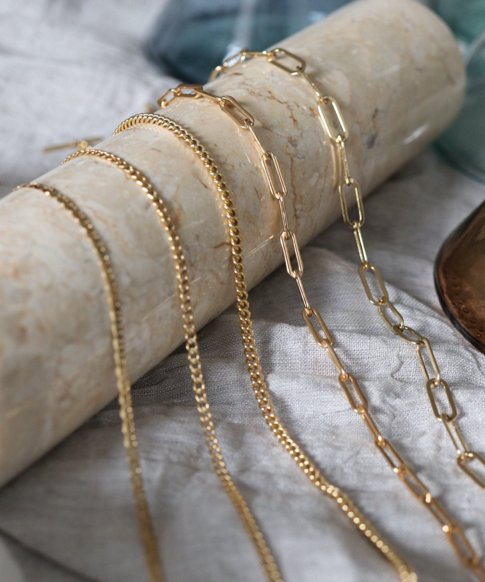 Assorted gold necklace chains from EVREN.