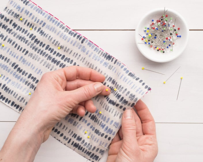 Pinning the edges of the fabric