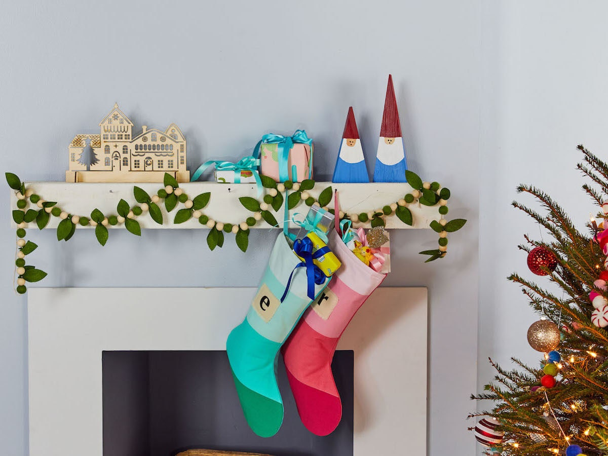 Holiday mantelscape featuring two colorful stockings