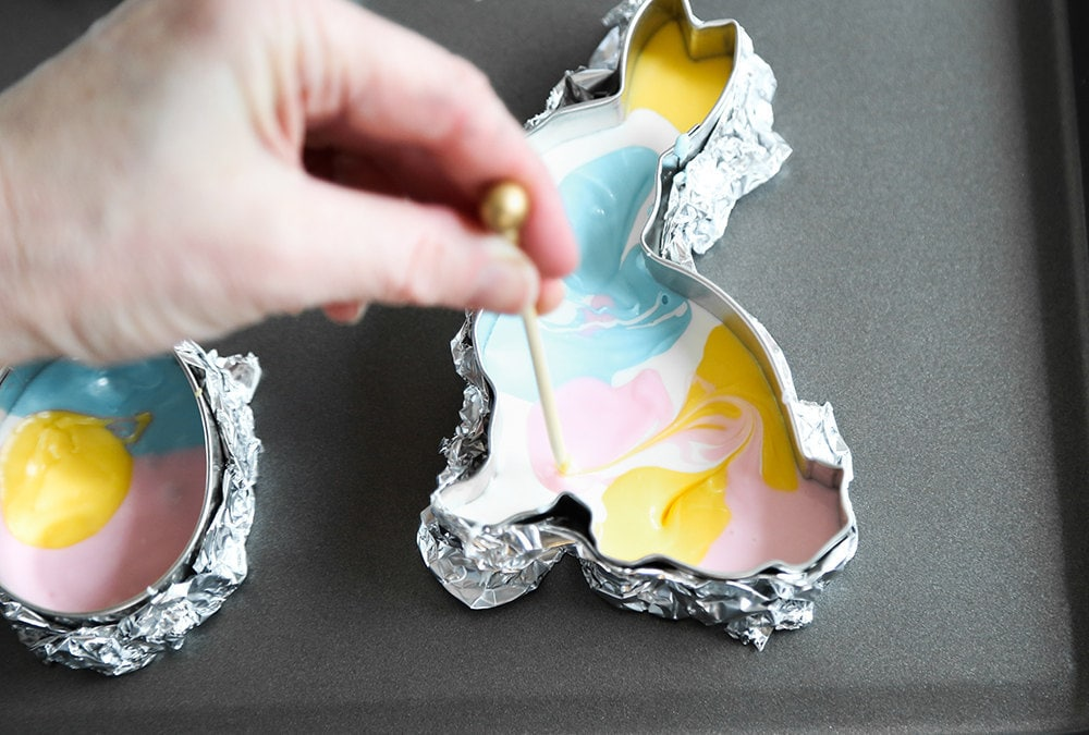 Heather swirls the chocolate with a toothpick to create a marbled effect