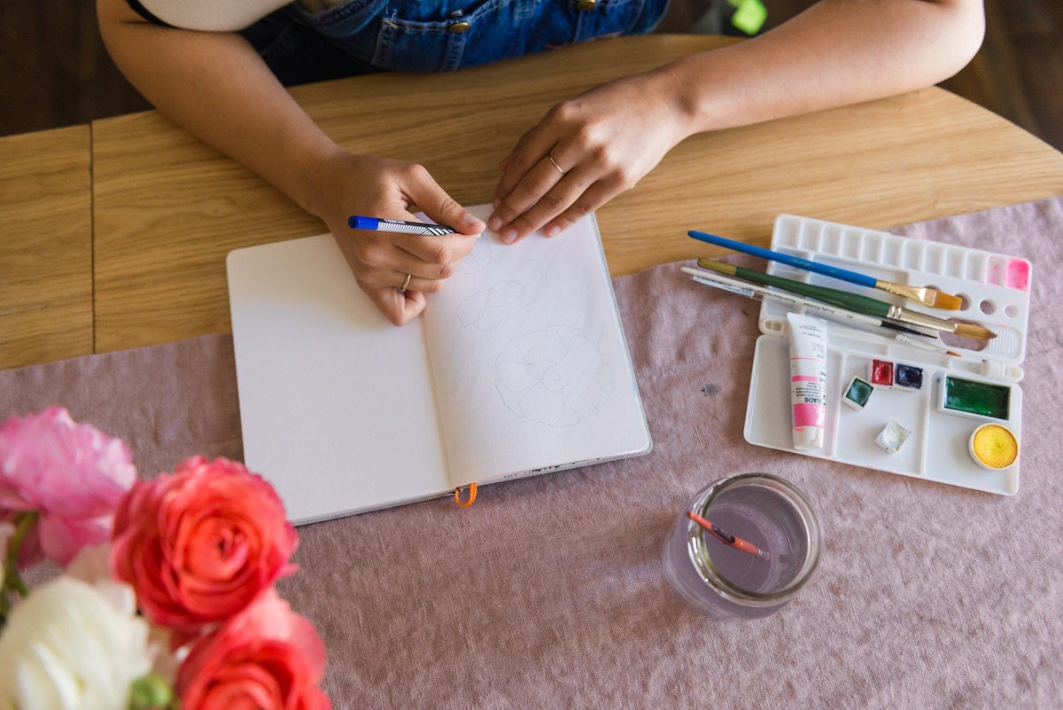 Melanie watercolors at her kitchen table