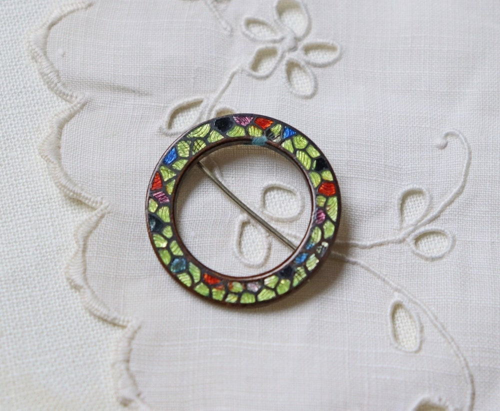 A vintage Christmas wreath brooch from Modish Vintage on Etsy