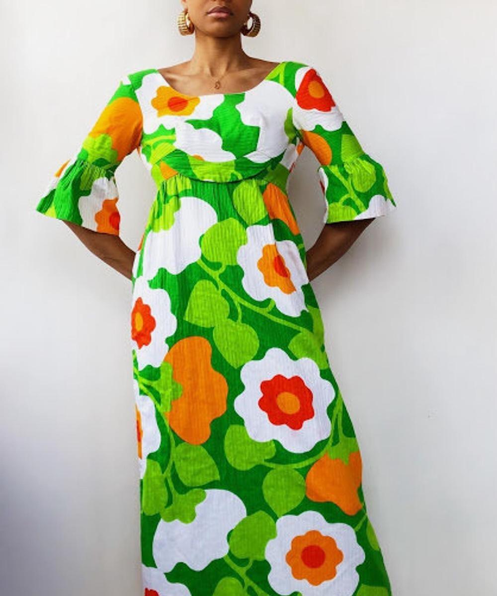 A vintage Hawaiian-print maxi dress from Threads of Habit