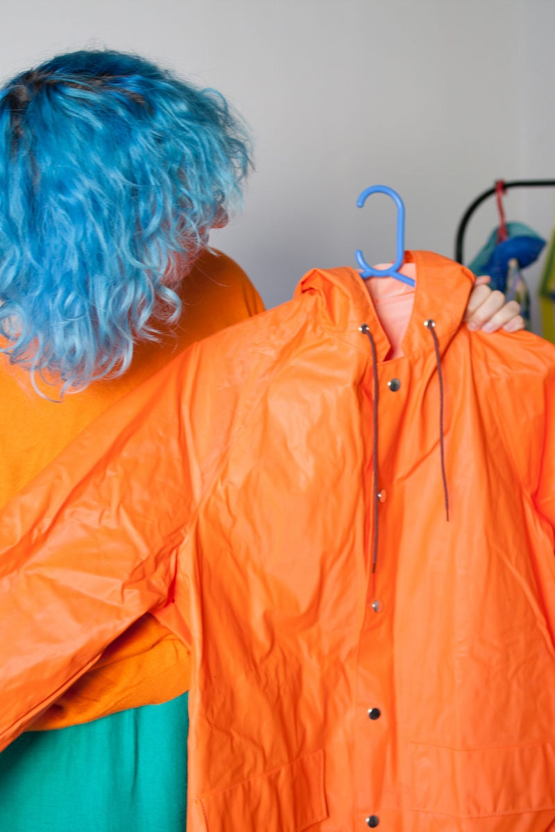 Agnieszka holding an orange rain jacket