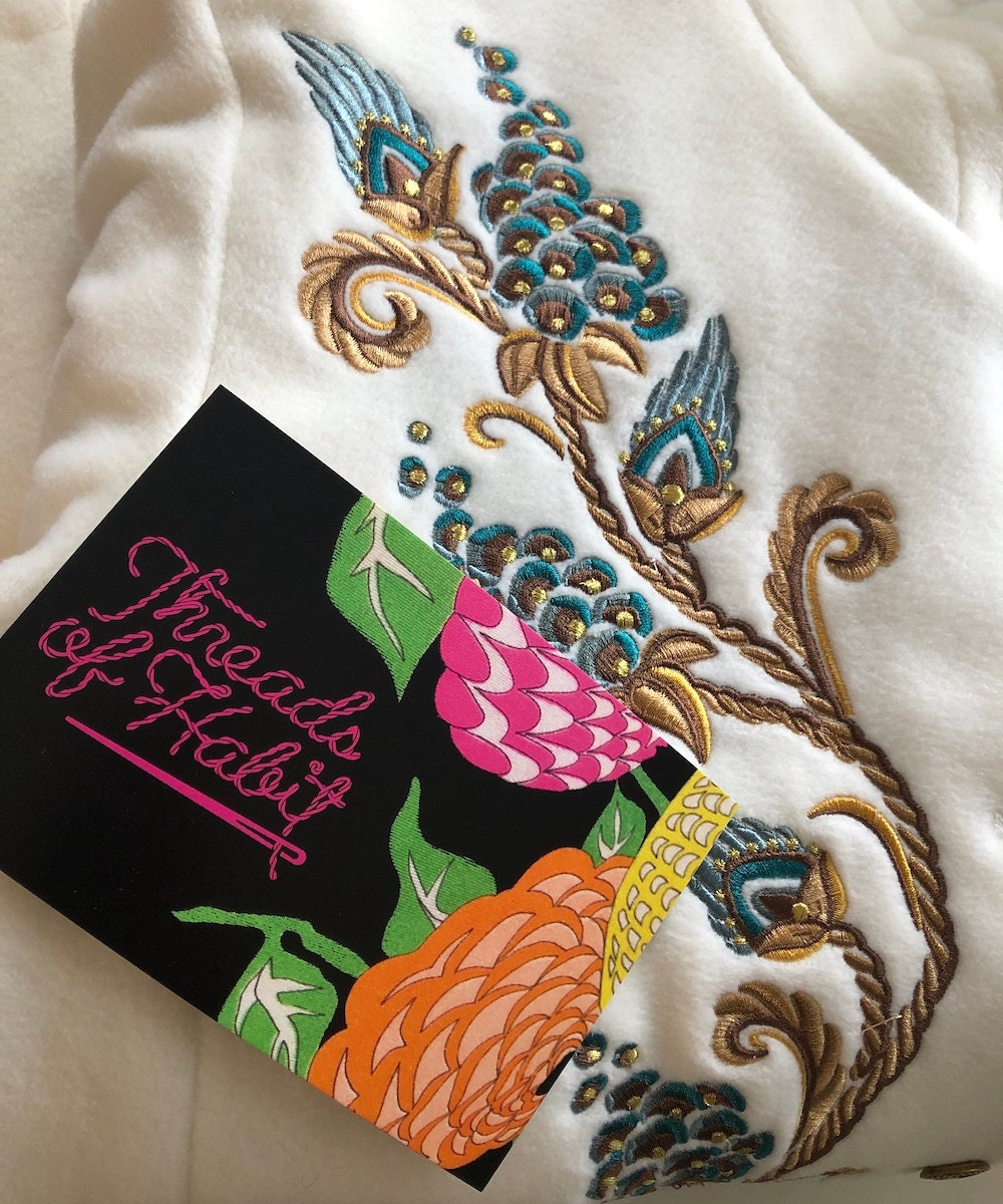 A Threads of Habit thank you card packaged in with a ready-to-ship vintage garment.