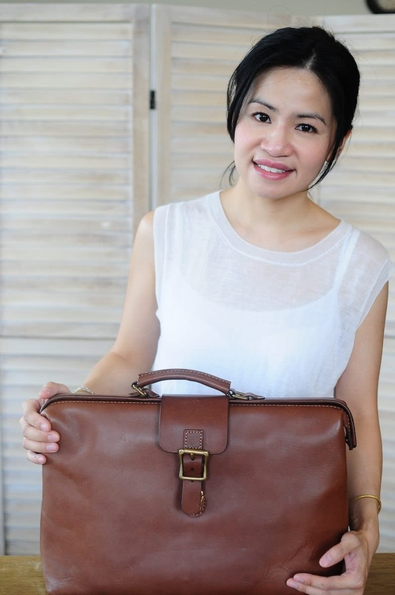Joe posing with one of her leather doctor bags