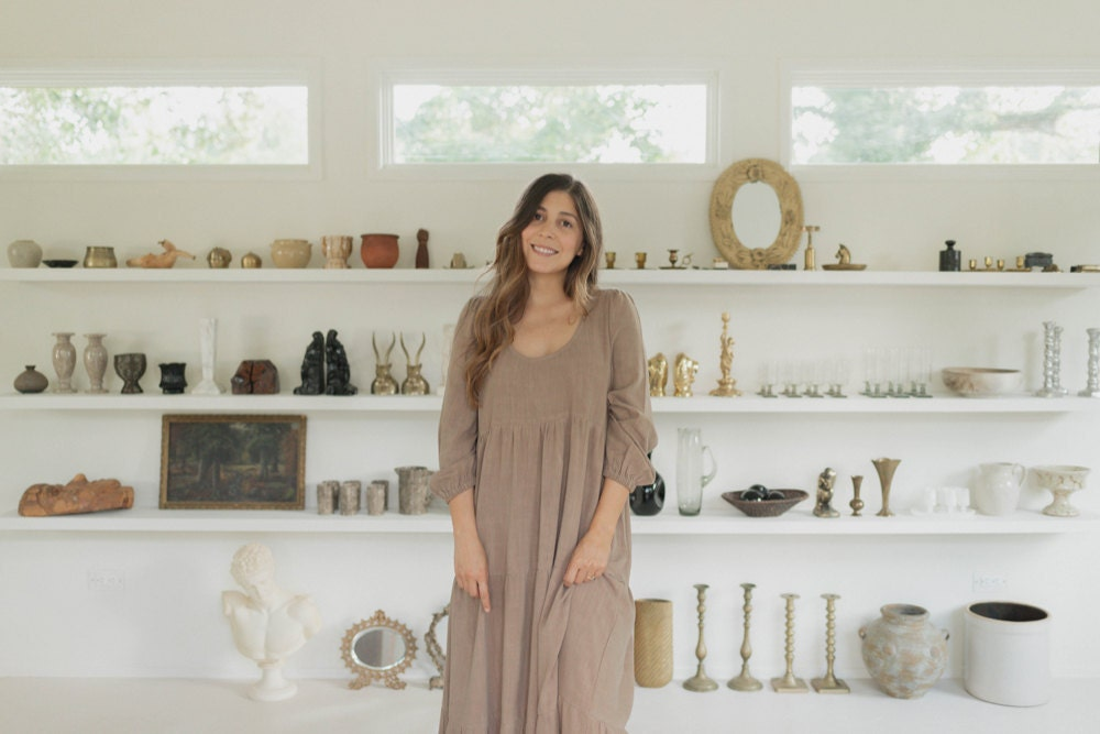 Portrait of Mara Caballero in front of her vintage stock.