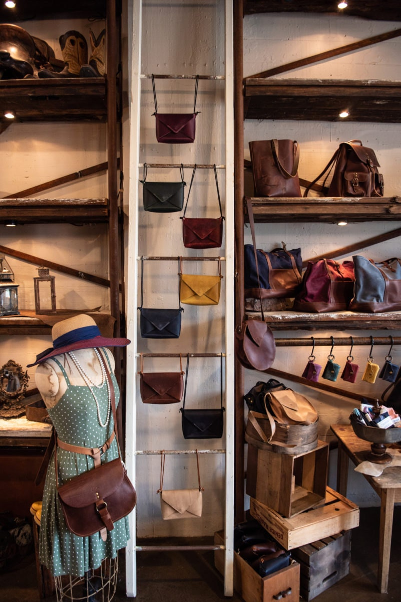 Purses, bags, and wallets on display inside the Holtz Leather Co. brick and mortar.