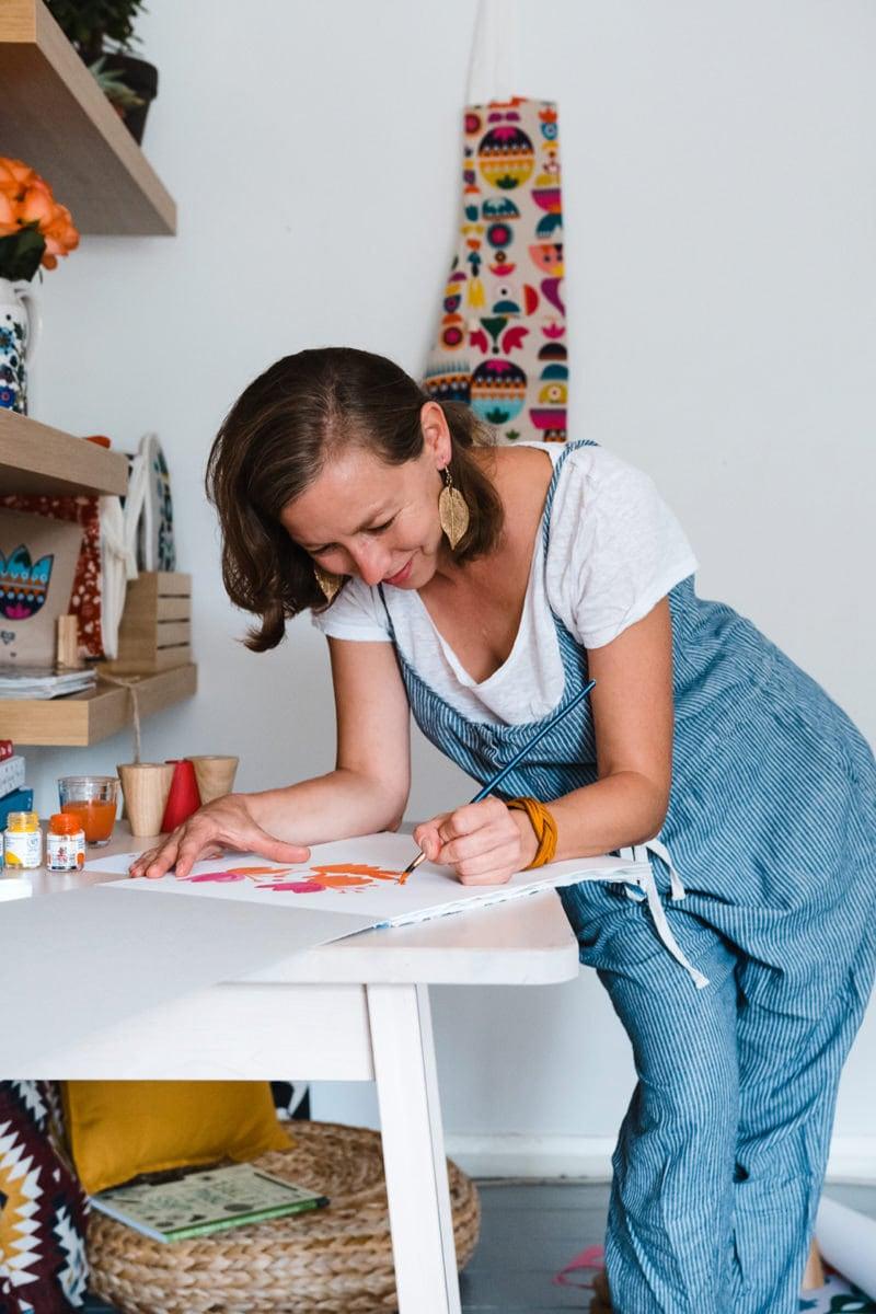 Tatiana painting at her workbench