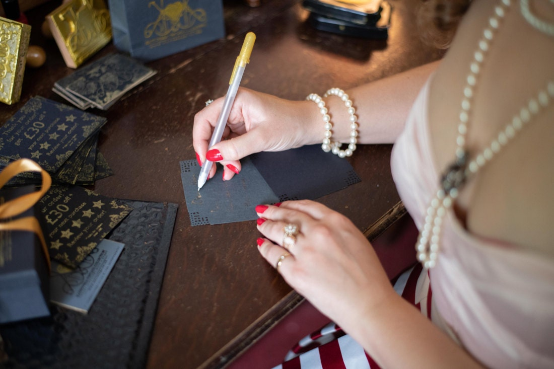 KK writes handwritten notes to her customers to include with their orders