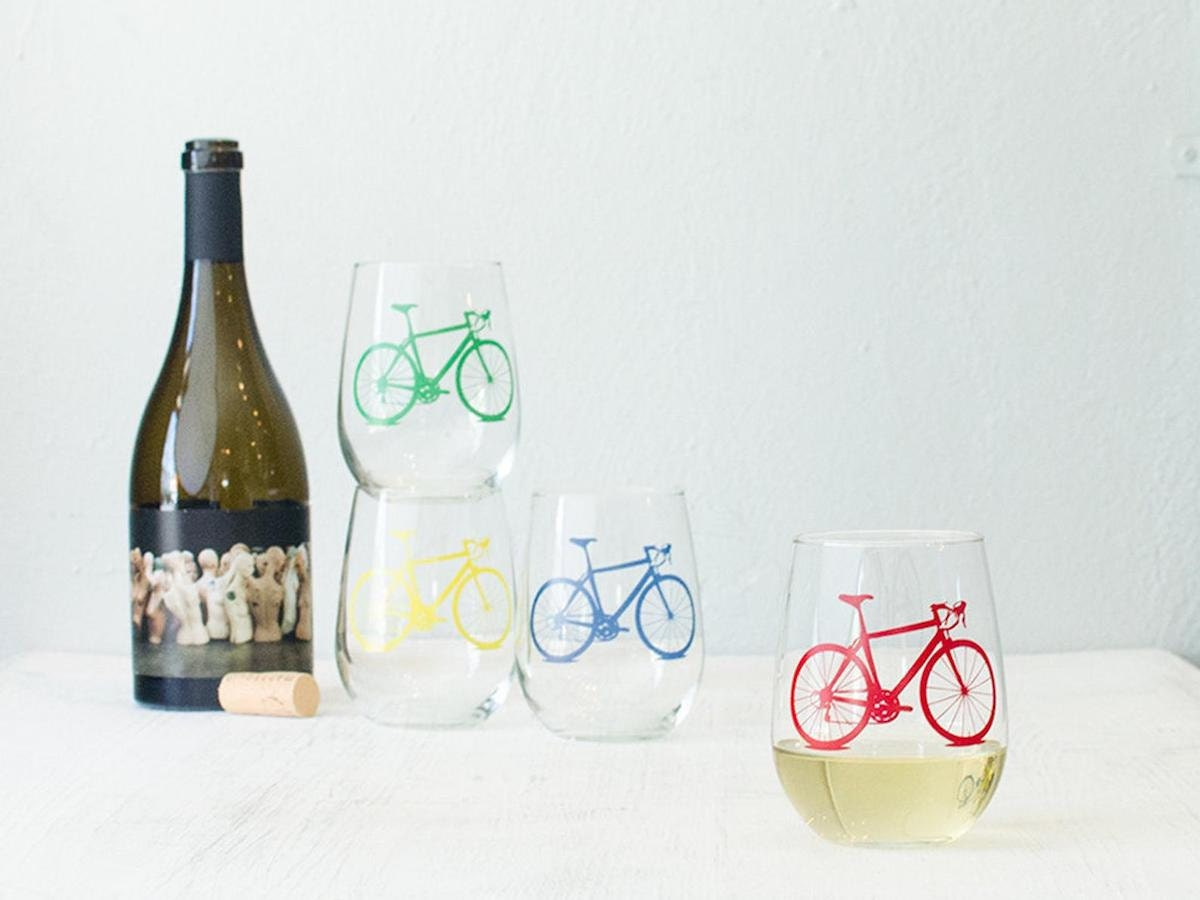 Stemless wine glasses with bicycle motif on Etsy