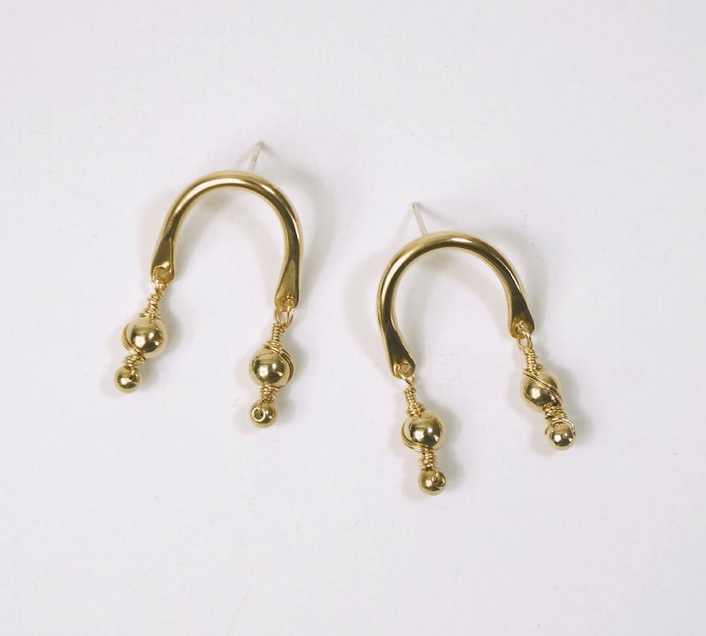 Brass arch dangle earrings from Aleishla
