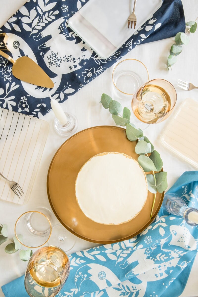 A styled tabletop featuring 2 woodland-themed tea towels from a set of 4
