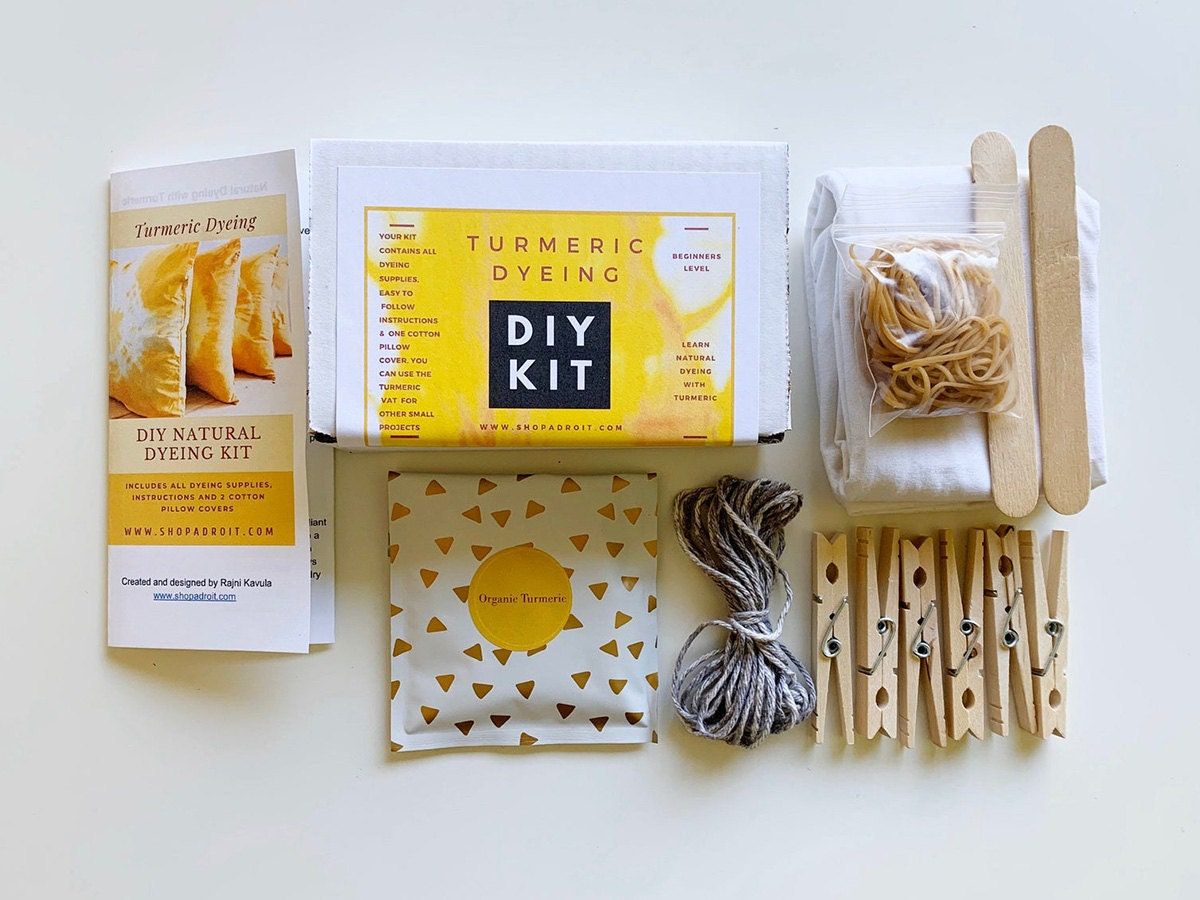 A kit of all the supplies needed to make yellow tie-dye pillows using turmeric.