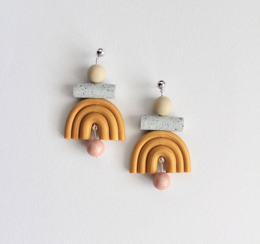 Gold geometric rainbow earrings from TSUNJA