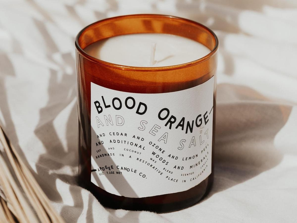 A styled photo of a blood orange candle from Apogee Candle Co.