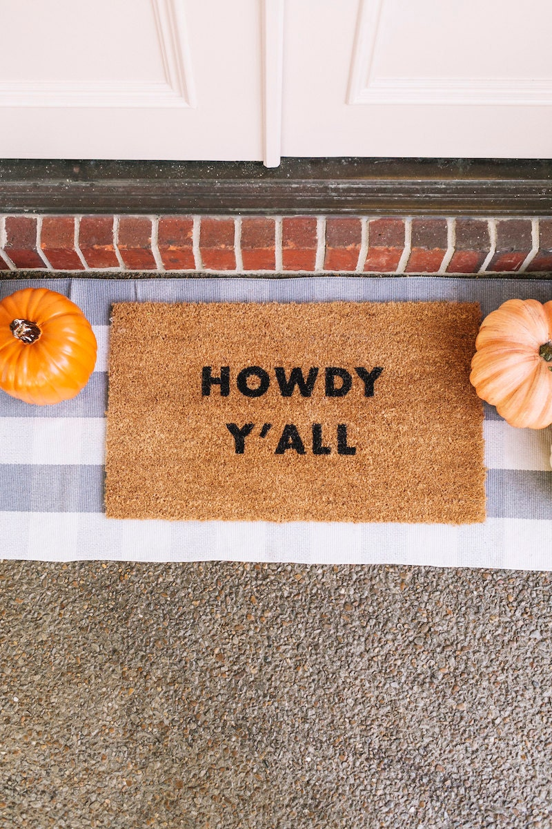 """""""Howdy Y'all"""" doormat from the A Beautiful Mess x Etsy collection"""