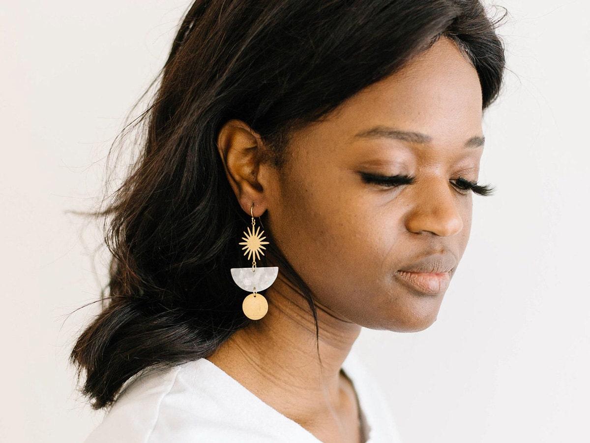 Starburst earrings on a model.