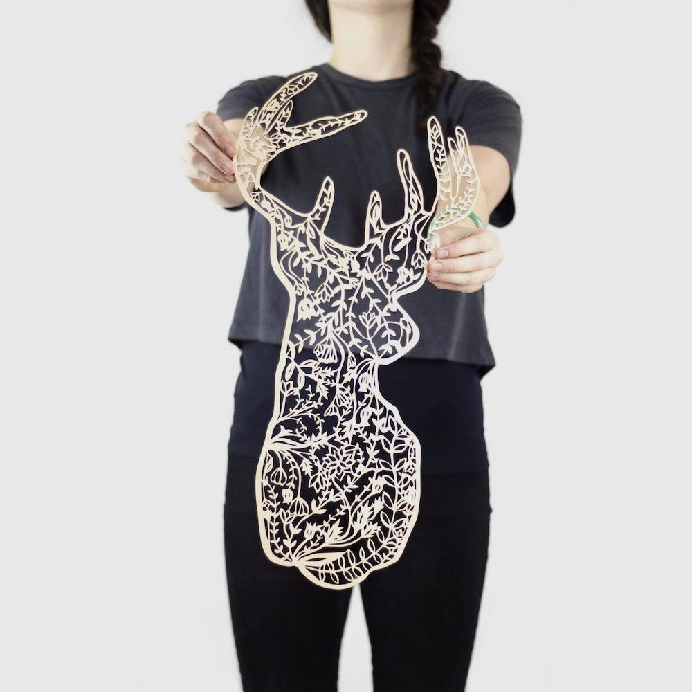 Laser-cut floral deer wall hanging from Light + Paper