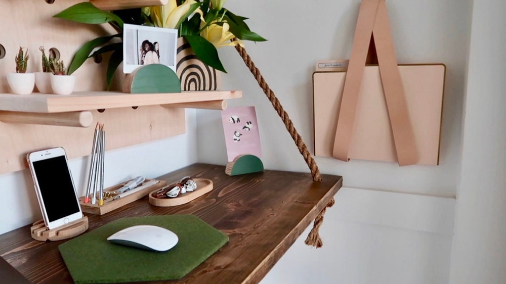 A custom floating desk from Endless Furniture on Etsy, accessorized with some of Janea's favorite home office finds.