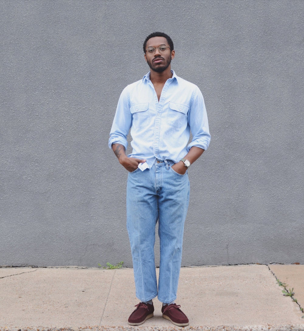 Norman models a vintage oxford and jeans.