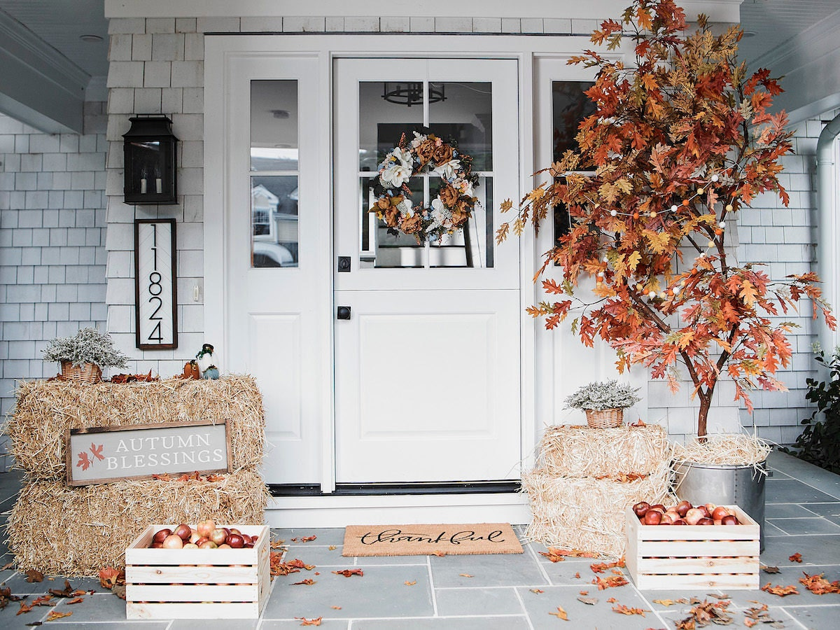 A festive front porch decorated for fall.