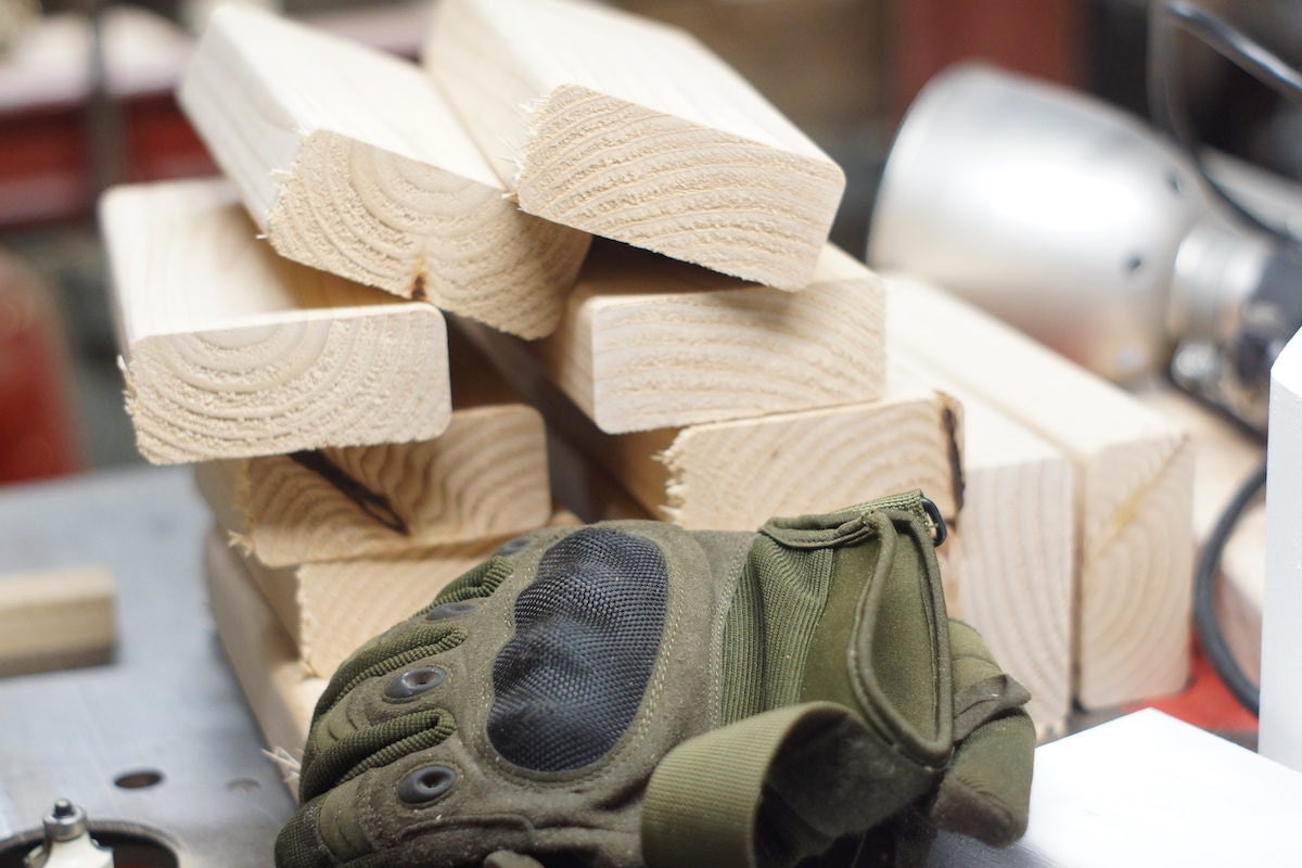 Pieces of raw wood and work gloves