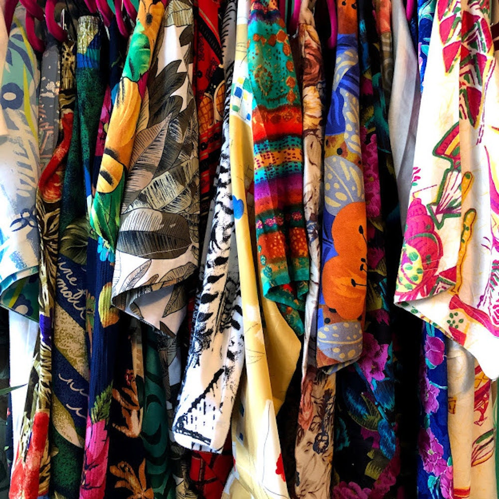 A closeup of the detail on a rack of Halima's patterned vintage pieces.