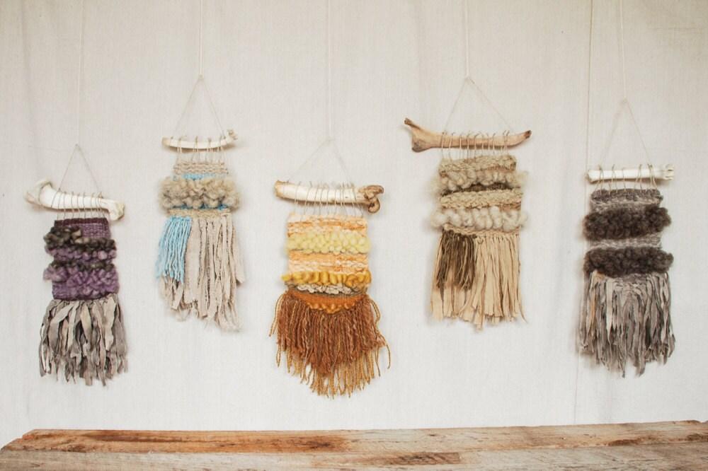 mini weavings hung on a wall